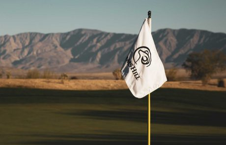 Flag that has Rams Hill logo at Rams Hill Golf Course with Santa Rosa mountains in the background