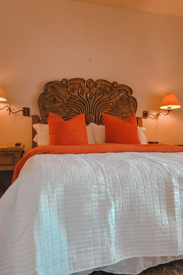 The Native Desert Sun master bedroom pillows and large bed